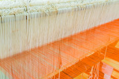 Weaving loom and shuttle on the warp Royalty Free Stock Photos