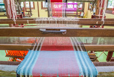 Weaving loom and shuttle on the warp Stock Photography