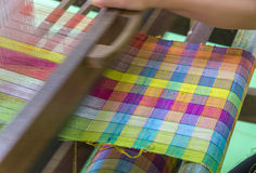 Weaving loom and shuttle on the warp Stock Image