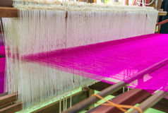 Weaving loom and shuttle on the warp Royalty Free Stock Images