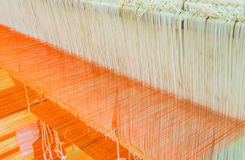 Weaving loom and shuttle on the warp Royalty Free Stock Image