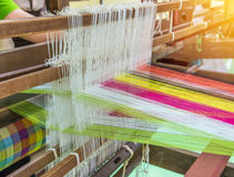 Weaving loom and shuttle on the warp Stock Photo