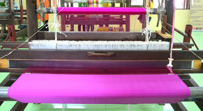 Weaving. Loom and shuttle on the warp Royalty Free Stock Image