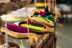 Weaving Loom and thread of yarn Stock Image