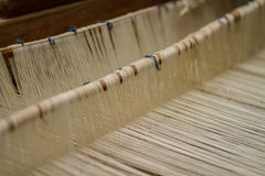 Weaving Loom and thread of yarn Stock Photo
