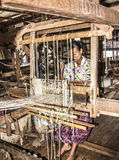 Weaving on a loom Royalty Free Stock Image