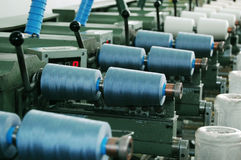 Weaving machine. Spin rollers working with many yarn rolls on a spinning machine stock images