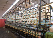 Weaving machine. S and filaments in the fabrics workshop Stock Image