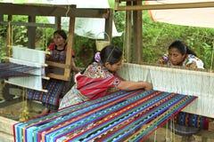 In weaving mill working Guatemalan Indian women. Guatemala, Chimaltenango Department, Patzaj Village: Economic activity, weaving by Indians in colorful royalty free stock image