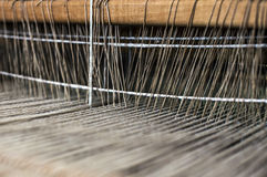 Weaving process. Weaving machine with some fabric Royalty Free Stock Photo