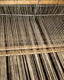 Weaving process. Weaving machine with some fabric Stock Images