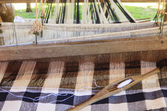 Weaving shuttle on thai tradition clothes weaving Royalty Free Stock Photos