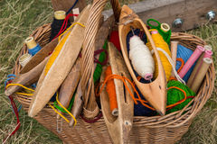 Weaving shuttles and  multi-colored yarn in a basket Stock Photography