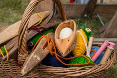 Weaving shuttles and  multi-colored yarn in a basket Stock Photos