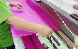 Weaving silk fabric Stock Photos