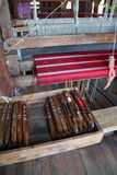 Weaving silk fabric on a wooden loom Royalty Free Stock Photos