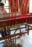 Weaving silk fabric on a wooden loom Stock Photos