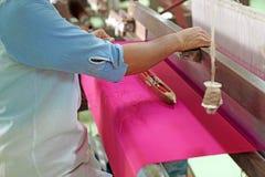 Weaving silk production process Royalty Free Stock Photo
