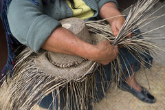 Weaving a straw hat. Hand weaving a straw hat in San Bartolome Ecuador royalty free stock photos