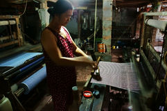 Weaving striped cloth by power loom Stock Images
