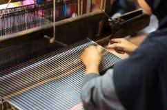 Weaving textile at Champa village, Mekong delta, Vietnam.  Royalty Free Stock Photo
