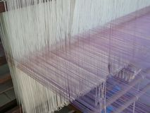 Weaving thread for the textile industry Royalty Free Stock Images