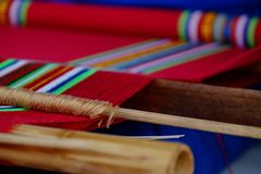 Weaving threads. Closeup on a threads during traditional hand weaving Royalty Free Stock Image