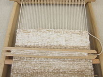 Weaving with weaving frame Royalty Free Stock Images