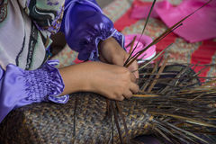 Weaving a wicker basket by handmade. Thailand Stock Photo