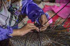 Weaving a wicker basket by handmade. Thailand Royalty Free Stock Photo