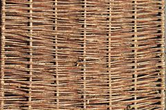 Weaving from willow branches. Background for the design of natural components. Handwork. Use of natural resources. Fence from tree. Branches. Environmentally royalty free stock image