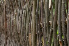 Weaving from willow branches. Fence from tree branches. stock images