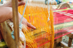 Weaving on a wooden loom Royalty Free Stock Photos