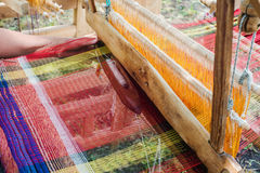 Weaving on a wooden loom Stock Photography