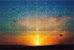 Sunset sky jigsaw puzzle nature background. Puzzle made of a picture of a beautiful colorful sunset sky with soft clouds and silhouettes of birds flying. Nature royalty free stock photography