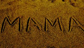 Mama word displayed on sand surface royalty free stock image