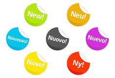 Web 2.0 Badges and stickers. Various colored sticky badges for internet websites - with the word new in different languages Royalty Free Stock Photos