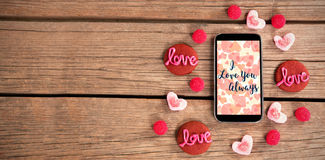 Web against love sweets around a smartphone stock photos