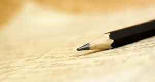 Pencil on a handwritten letter Stock Images