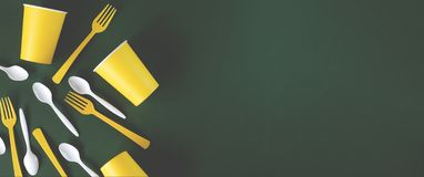 Web banner yellow and white dishes on a green background. royalty free stock photo