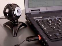 Web camera. Close-up web camera at laptop and usb flash Royalty Free Stock Photography