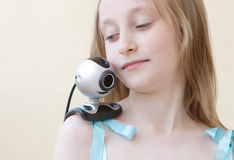 Web camera 'pet'. Girl with web-camera as a parrot on her shoulder Stock Photos