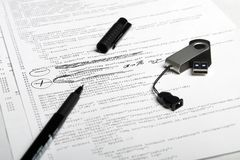 Web code pen & flash 5. Photo of document with web code & USB flash Royalty Free Stock Photos