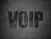 Web design concept: VOIP on grunge wall background. Web design concept: Black VOIP on grunge textured concrete wall background Stock Image
