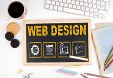 Web Design concept. Chalkboard on white office desk Royalty Free Stock Photography
