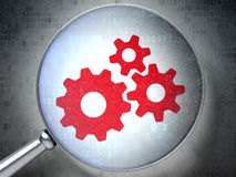 Web design concept:  Gears with optical glass on digital backgro Stock Photography