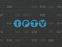 Web design concept: IPTV on wall background. Web design concept: Painted blue text IPTV on Black Brick wall background with Binary Code, 3d render royalty free stock image