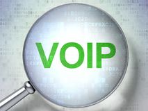 Web design concept: VOIP with optical glass. Web design concept: magnifying optical glass with words VOIP on digital background, 3D rendering Royalty Free Stock Photo