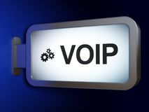 Web design concept: VOIP and Gears on billboard background. Web design concept: VOIP and Gears on advertising billboard background, 3D rendering Royalty Free Stock Photos