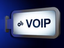 Web design concept: VOIP and Gears on billboard background. Web design concept: VOIP and Gears on advertising billboard background, 3D rendering Royalty Free Stock Photography